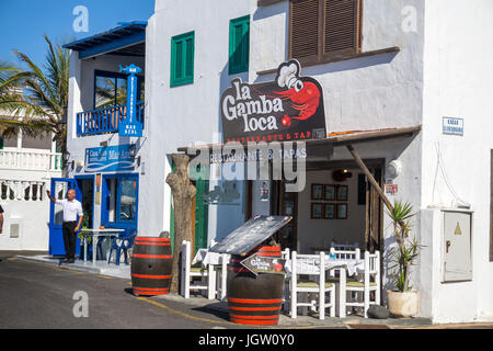 Seafood restaurant and Tapas-Bar at fishing village El Golfo, Lanzarote island, Canary islands, Spain, Europe - Stock Photo