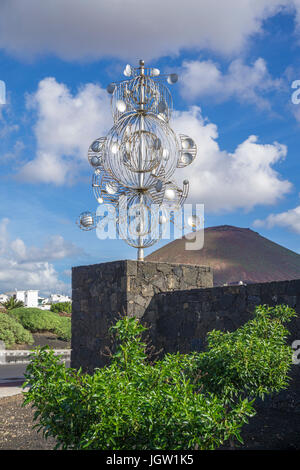 Silver wind chime, sculpture at a crossroad, exit to Fundacion Cesar Manrique, Tahiche, Lanzarote island, Canary - Stock Photo