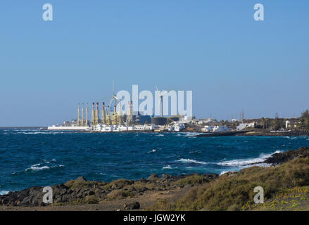 View from rocky coast of Teguise on desalination facility of Arrecife, Canary islands, Spain, Europe - Stock Photo