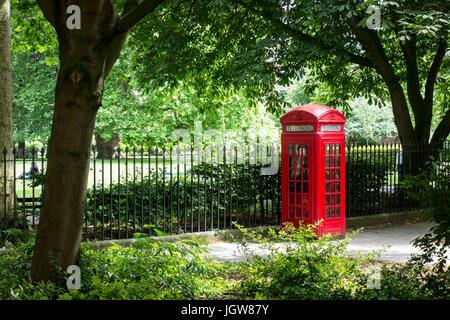 Traditional Telephone Box outside Brunswick Square Gardens, London, UK - Stock Photo