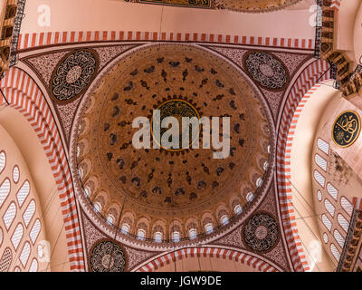 ISTANBUL, TURKEY - MAY 05, 2017: Interior view of domes and ceilings of Suleymaniye mosque, largest mosque of Istanbul - Stock Photo