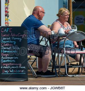 Couple at pavement cafe, Poole, Dorset, England, UK - Stock Photo
