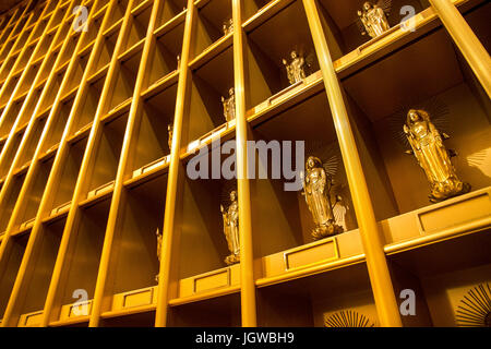 Golden standing statues of Buddha inside Ushiku Daibutsu, Ibaraki prefecture, Japan - Stock Photo