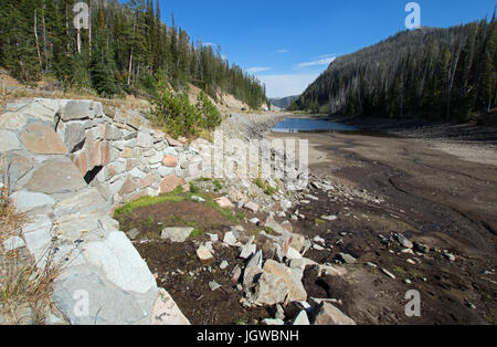 Stone bridge at drought stricken Eleanor Lake on Sylvan Pass on the highway to the east entrance of Yellowstone - Stock Photo
