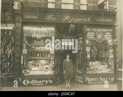 Late 1920's postcard (cropped proof) of The Regent confectioner and tobacconists shop selling sweets and tobacco - Stock Photo