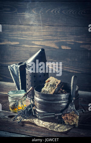 Beekeeper vintage tools and fresh honey with flowers Stock Photo ...