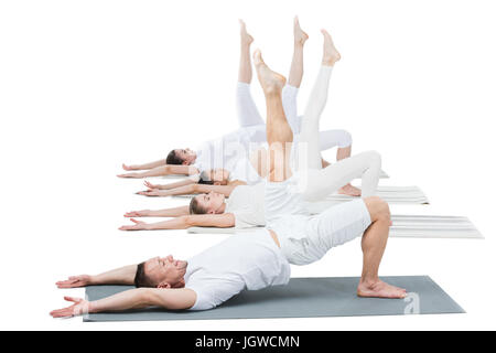 side view of people performing bridge Yoga Pose isolated on white - Stock Photo