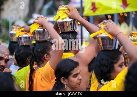 Hindu pilgrims with milk pot kavaldi queueing at batu cave temple, Kuala Lumpur Malaysia during Thaipusam festival - Stock Photo