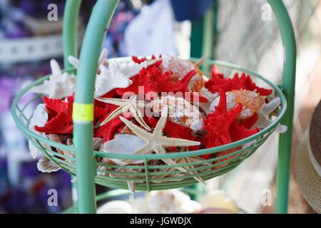 MAKARSKA RIVIERA,CROATIA - 20 JUNE,2017: Buy sovenir in the street shop.Starfish for sovernirs.Natural star-shaped - Stock Photo
