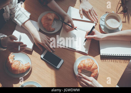cropped view of people having lunch at meeting in cafe, business lunch concept - Stock Photo