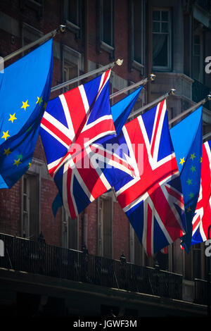 Flags of the European Union and United Kingdom flying next to each other - Stock Photo