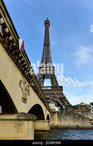 The Eiffel Tower along the Seine River in Paris, France. - Stock Photo