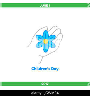 Happy Childrens Day. The child's hand holds a blue flower, a symbol of innocence - Stock Photo