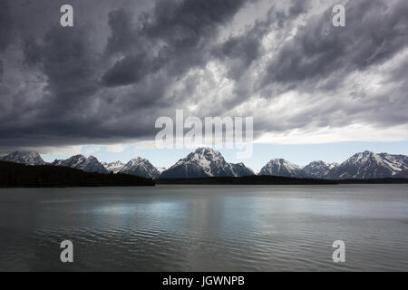 Dark clouds over the Tetons as a storm approaches. As seen from Teton Park Road on the shores of Jackson Lake near - Stock Photo