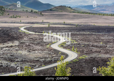 Loop road in Craters of the Moon National Monument & Preserve, Idaho as seen from Broken Top Trail - Stock Photo