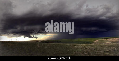Rotating supercell cloud over rural area, Cope, Colorado, United States, North America - Stock Photo