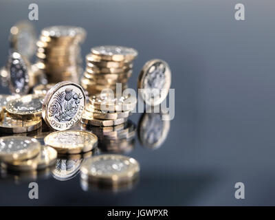 Pile of new British one pound coins, close-up - Stock Photo