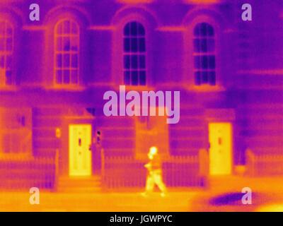 Thermal photograph of two tourists walking along sidewalk, London, UK - Stock Photo