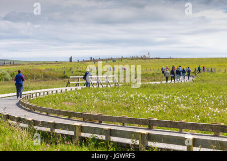 Tourists visiting the neolithic site the Ring of Brodgar, Orkney Scotland UK - Stock Photo