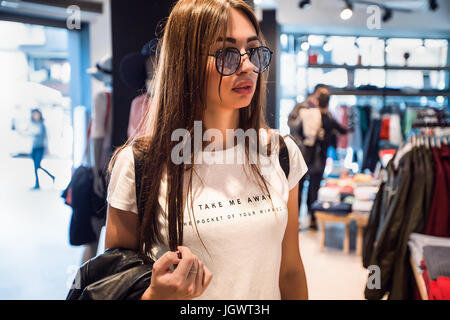 Shopper walking around in shopping complex - Stock Photo