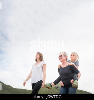 Senior woman walking with daughter and grandson - Stock Photo