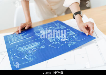 Involved in the creation process. Skilled creative female architect working on the project and making the draft - Stock Photo