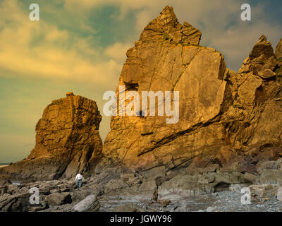 Large outcrop on the Cornwall coast, UK - Stock Photo
