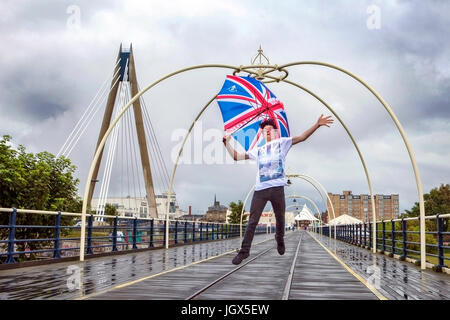Southport, Merseyside, 11th July 2017. UK Weather. The dreadful weather doesn't dampen this young man's spirits - Stock Photo