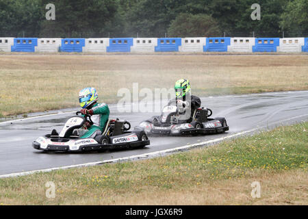 Surrey, UK. 11th Jul, 2017. Teams compete at the Henry Surtees Foundation Brooklands Karting Challenge at Mercedes - Stock Photo