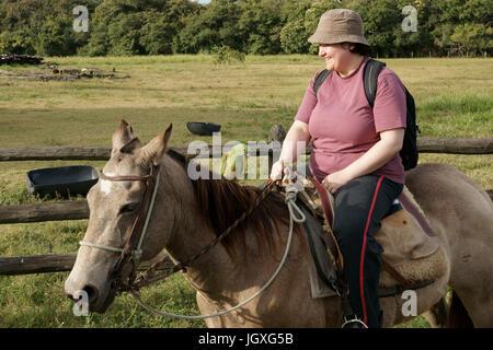 Animals, Woman Riding, Pantanal, Mato Grosso do Sul, Brazil - Stock Photo