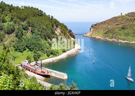 A bucket dredging ship in dry dock in the fjord of Pasajes (Guipuzkoa - Spain).  Pasajes (or Pasaia) is the San - Stock Photo