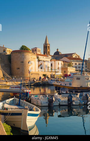 Alghero Sardinia, view of the Alghero skyline with the harbour and port area in the foreground, Sardinia, Italy. - Stock Photo