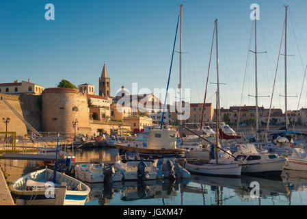 Sardinia port harbour, view of the Alghero skyline with the harbor and port area in the foreground, Sardinia, Italy. - Stock Photo