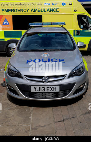 Police car and ambulance parked in the centre center of York, UK. - Stock Photo