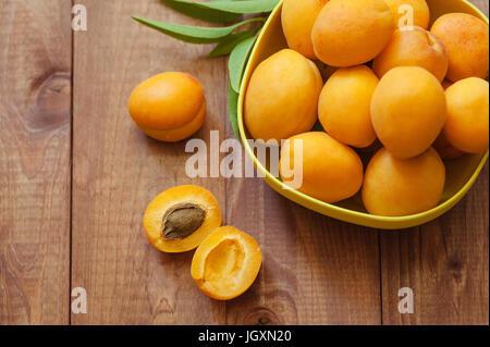 Apricot fruit. Fresh organic apricots on a white wooden background. Vega food. - Stock Photo