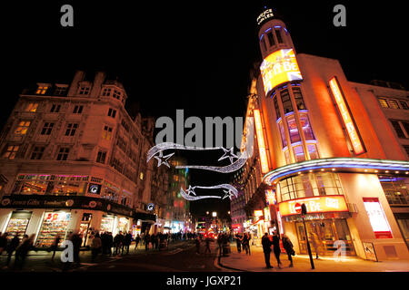 London , UK - December 11, 2012: Night street view of Leicester Square, pedestrianised square in the West End of - Stock Photo