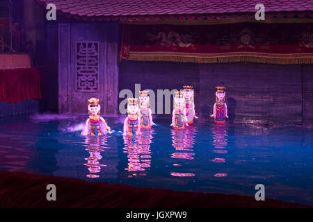 Water puppets show at the Thang Long water puppet theatre in Hanoi, Vietnam - Stock Photo