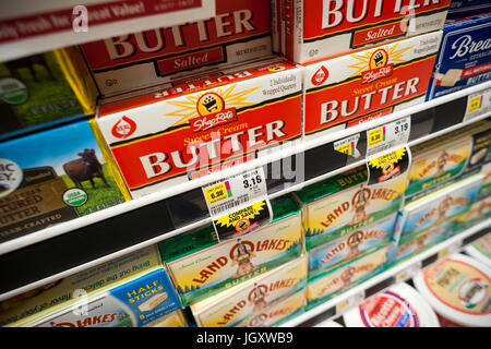 Butters are seen in a refrigerated case in a supermarket in New York on Thursday, July 6, 2017. The UN Food and - Stock Photo