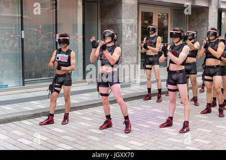 'Minutiens' Street performers with VR headsets during Montreal Circus Arts Festival 2017 - Stock Photo