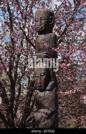 African ground idols erected in front of the Elephant House at Budapest Zoo in Budapest, Hungary. The original column - Stock Photo