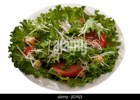 Green salad with tomatoes and shredded cheese - Stock Photo