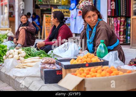 Leh, Ladakh, India, July 12, 2016: produce vendors on a sidewalk market in Leh, Ladakh district of Kashmir, India - Stock Photo
