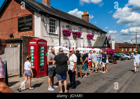 People Drinking Outside The Foresters Arms Pub, Fairwarp, East Sussex, UK - Stock Photo