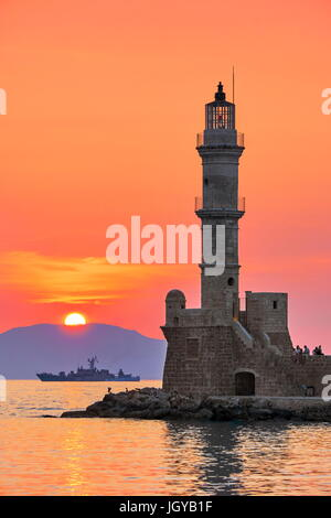 Sunset over the Chania lighthouse, Crete Island, Greece - Stock Photo