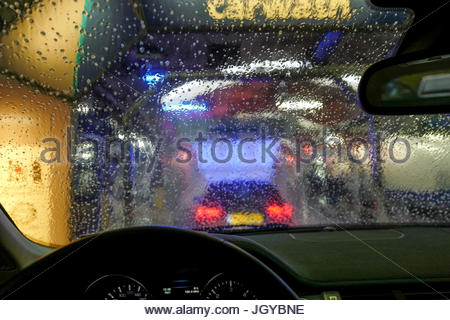 Carwash through a window - Stock Photo