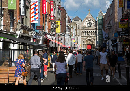 People in Dublin city, Ireland. - Stock Photo