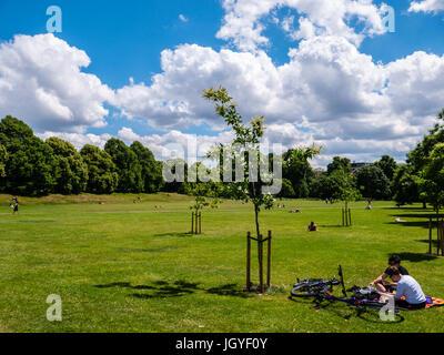 People Relaxing in Kensington Gardens, London, England - Stock Photo