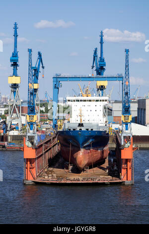 container ship in floating dock for maintenance - Stock Photo