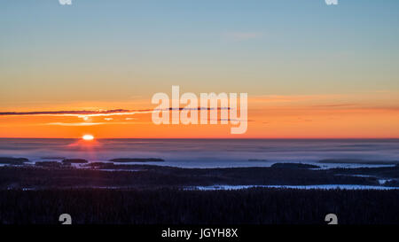 Winter sunrise in Finland - Stock Photo