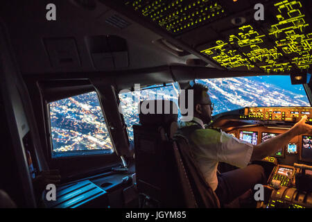 Two Pilots Departing out of Dallas Fort Worth Airport. Crew resource management taking place, both working together. - Stock Photo